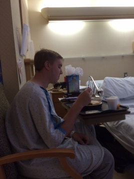 Micah Krey eating his first meal after 3 days in the hospital after being diagnosed with pancreatitis.